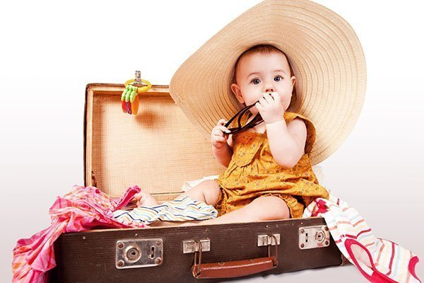 packing up your suitcase for travel with baby