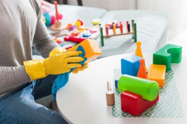 Parent cleans and disinfects toys