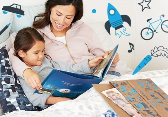 Mother and daughter read books from Amazon Prime Book Box subscription