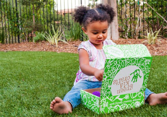 Child opens Green Kids Crafts subscription box