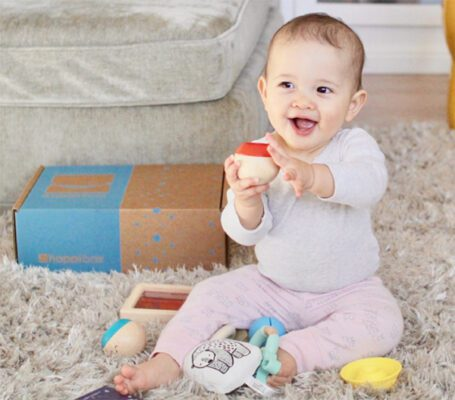 Baby plays with toys from Hoppi Box