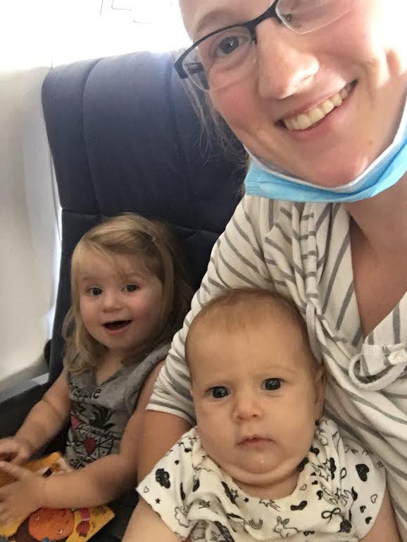 Courtney and her daughters sitting on the plane